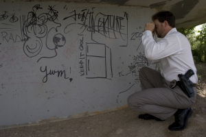 Officer Taking Pictures of Graffiti