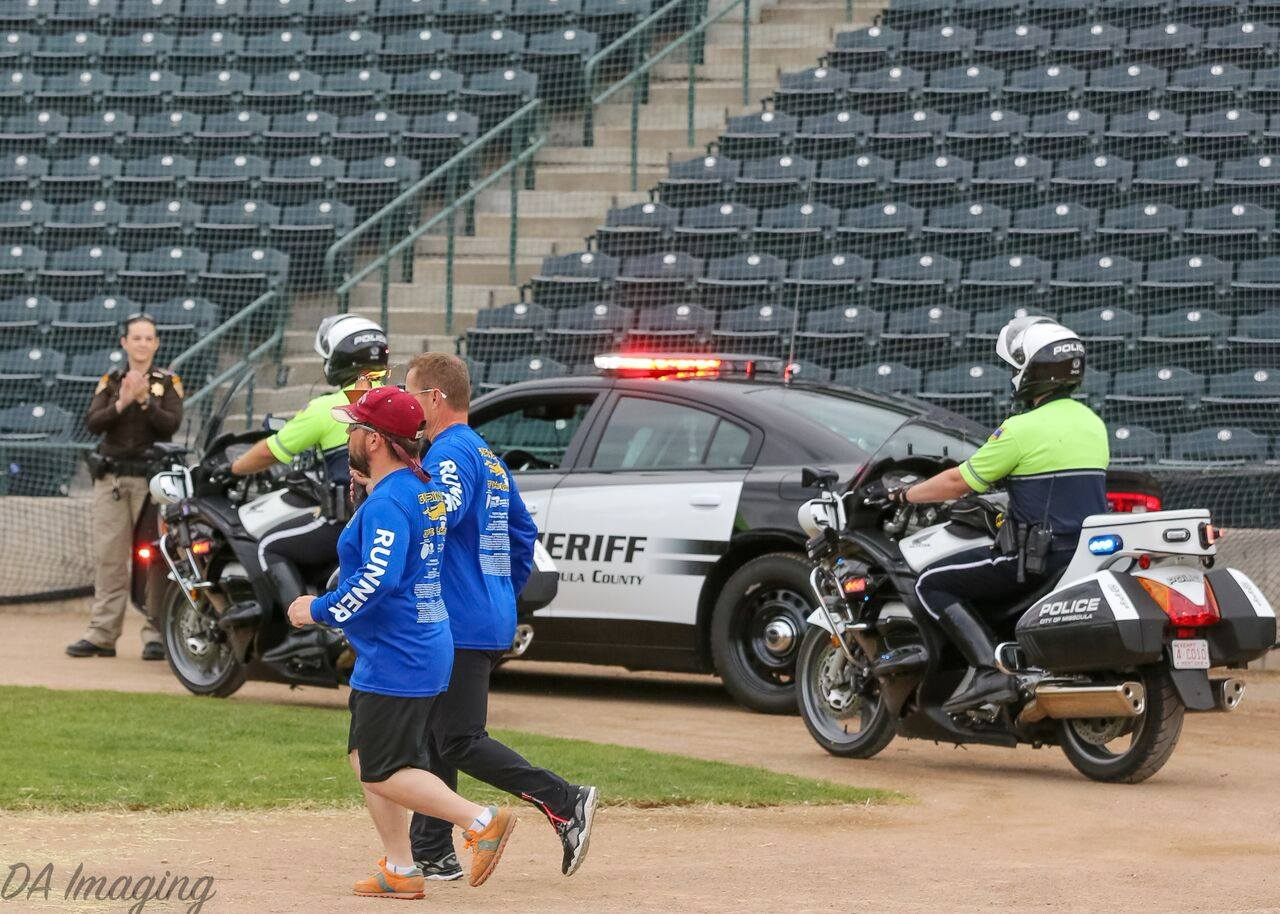 Special Olympics Torch Run with motorcycle officer escort