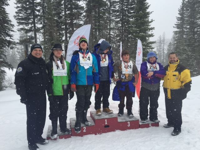 Group of People in Snow Receiving Medals