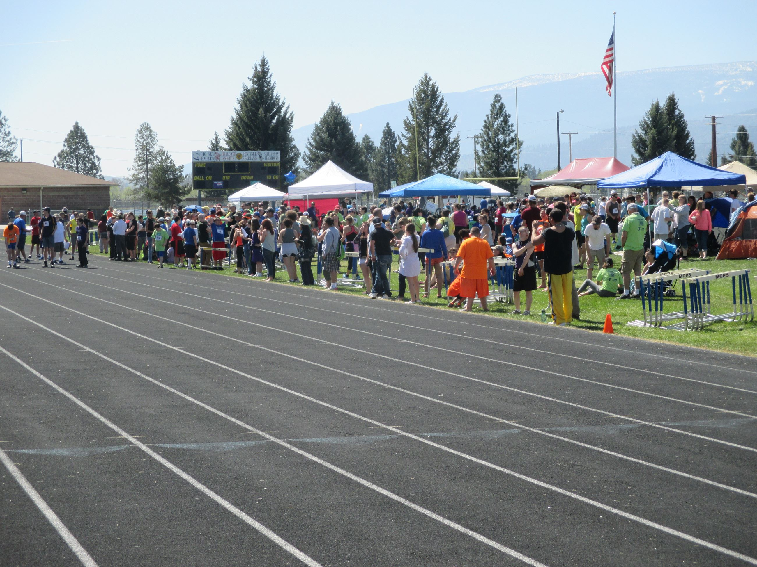 Group Standing Next to the Track