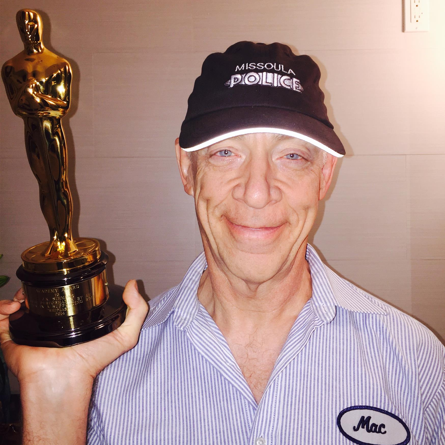 J.K. Simmons showing off his MPD hat. And his Oscar.