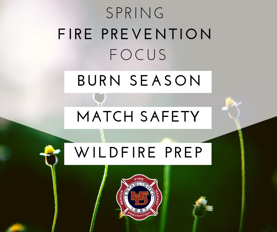 Flowers sprout in spring behind fire safety messages.
